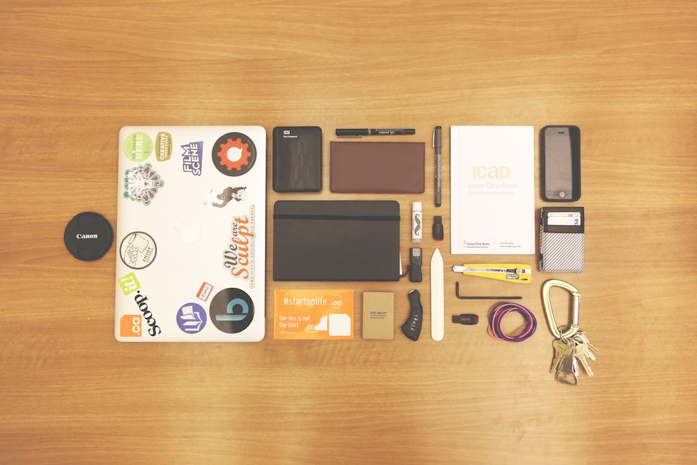 desk with office gadgets aligned neatly