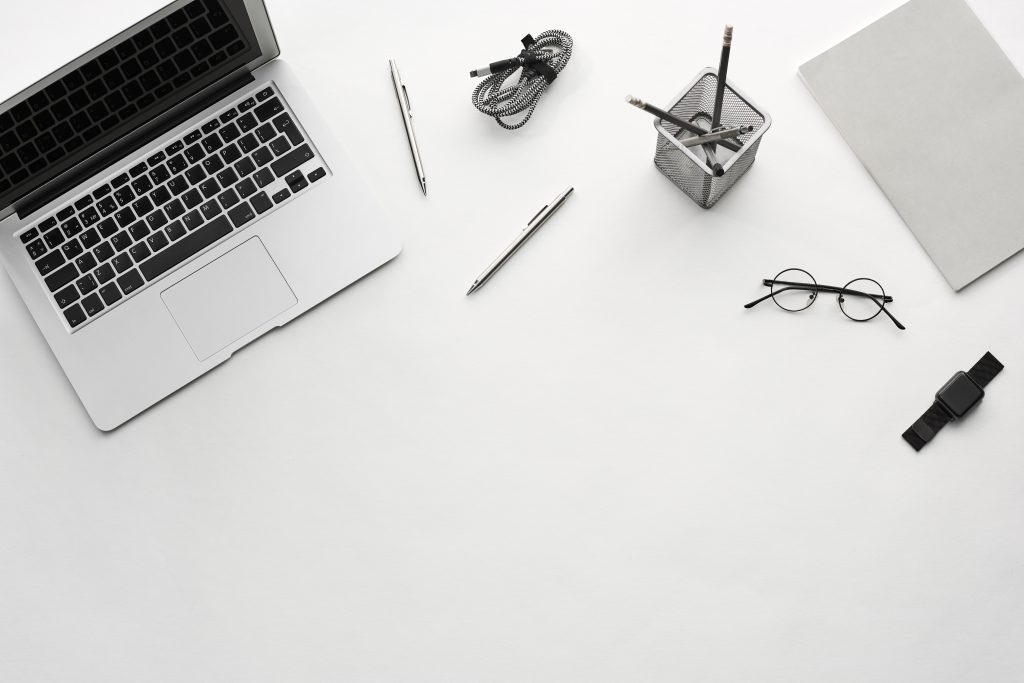 desk with computer pen glases